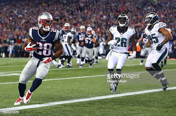 James White of the New England Patriots runs after catching a touchdown pass during the second quarter against the Philadelphia Eagles at Gillette...