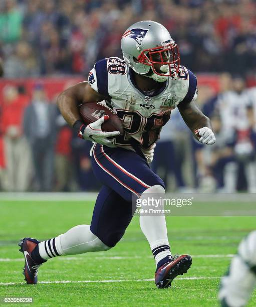 James White of the New England Patriots runs the ball against the Atlanta Falcons during the fourth quarter during Super Bowl 51 at NRG Stadium on...