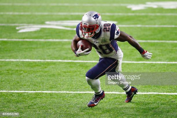 James White of the New England Patriots runs with the ball against the Atlanta Falcons during Super Bowl 51 at NRG Stadium on February 5 2017 in...