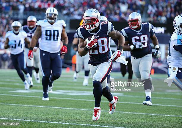 James White of the New England Patriots runs with the ball on his way to scoring a touchdown after catching a pass from Tom Brady of the New England...