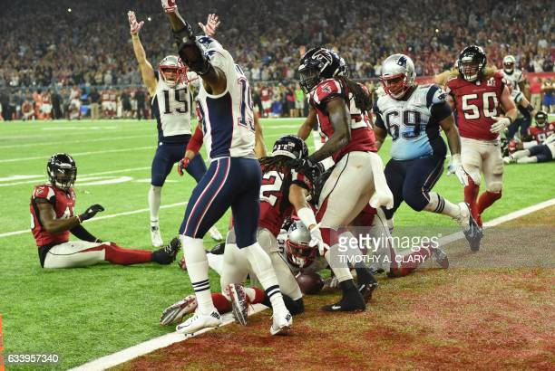 TOPSHOT James White of the New England Patriots scores the game winning touchdown in overtime against the Atlanta Falcons during Super Bowl 51 at NRG...