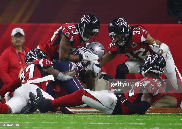 James White of the New England Patriots scores the winning touchdown in overtime against Robert Alford Jalen Collins Ricardo Allen and Deion Jones of...
