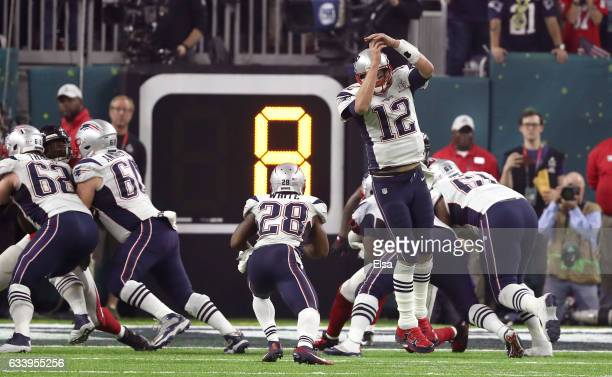 James White of the New England Patriots takes a direct snap and scores on a two point conversion in the fourth quarter against the Atlanta Falcons...