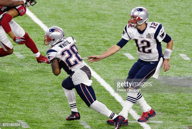 James White of the New England Patriots takes the handoff from Tom Brady against the Atlanta Falcons during Super Bowl 51 at NRG Stadium on February...