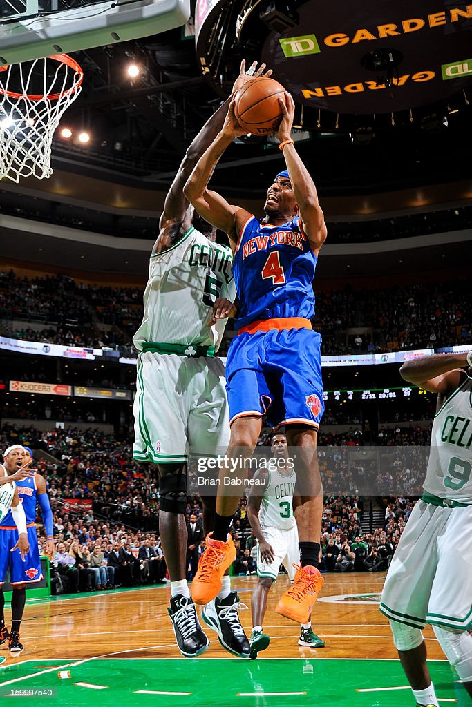 James White #4 of the New York Knicks drives to the basket against Kevin Garnett #5 of the Boston Celtics on January 24, 2013 at the TD Garden in Boston, Massachusetts.