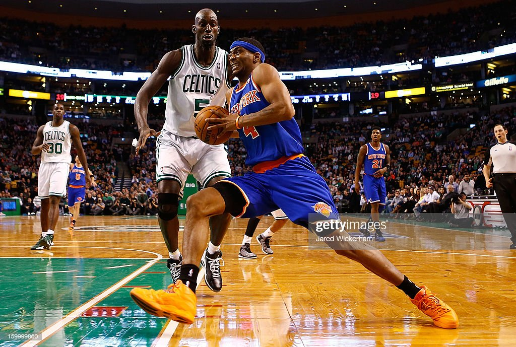 James White #4 of the New York Knicks drives to the basket against Kevin Garnett #5 of the Boston Celtics during the game on January 24, 2013 at TD Garden in Boston, Massachusetts.