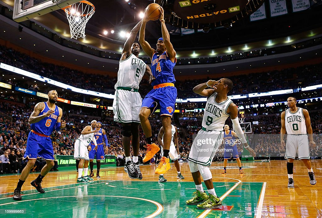 James White #4 of the New York Knicks goes up for a layup against Kevin Garnett #5 of the Boston Celtics during the game on January 24, 2013 at TD Garden in Boston, Massachusetts.