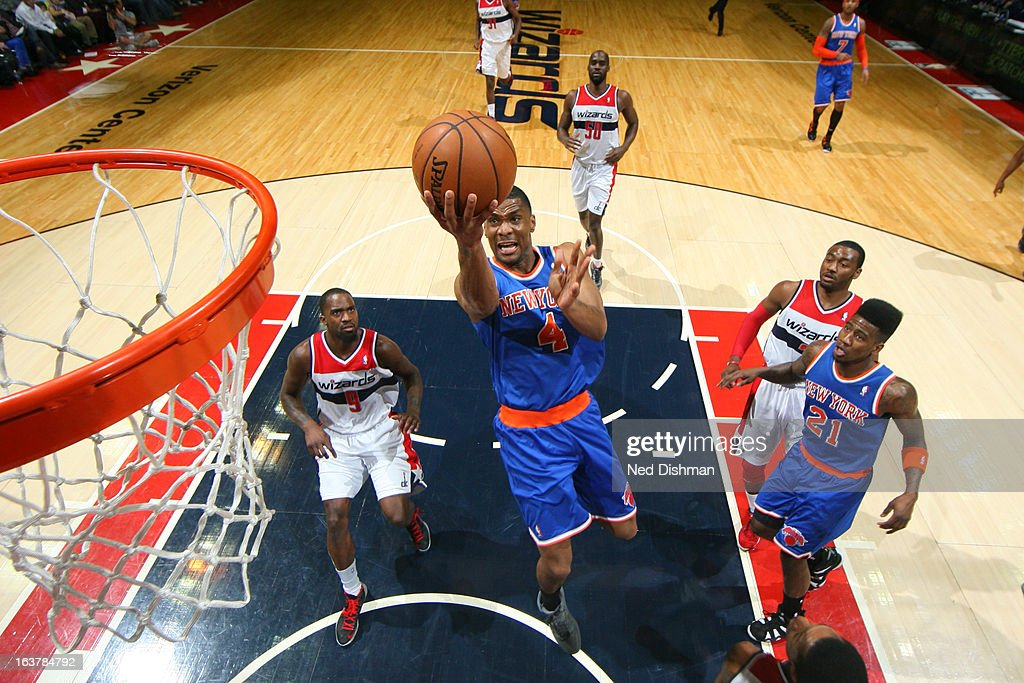James White #4 of the New York Knicks shoots a layup against <a gi-track='captionPersonalityLinkClicked' href=/galleries/search?phrase=Martell+Webster&family=editorial&specificpeople=601785 ng-click='$event.stopPropagation()'>Martell Webster</a> #9 of the Washington Wizards at the Verizon Center on March 1, 2013 in Washington, DC.