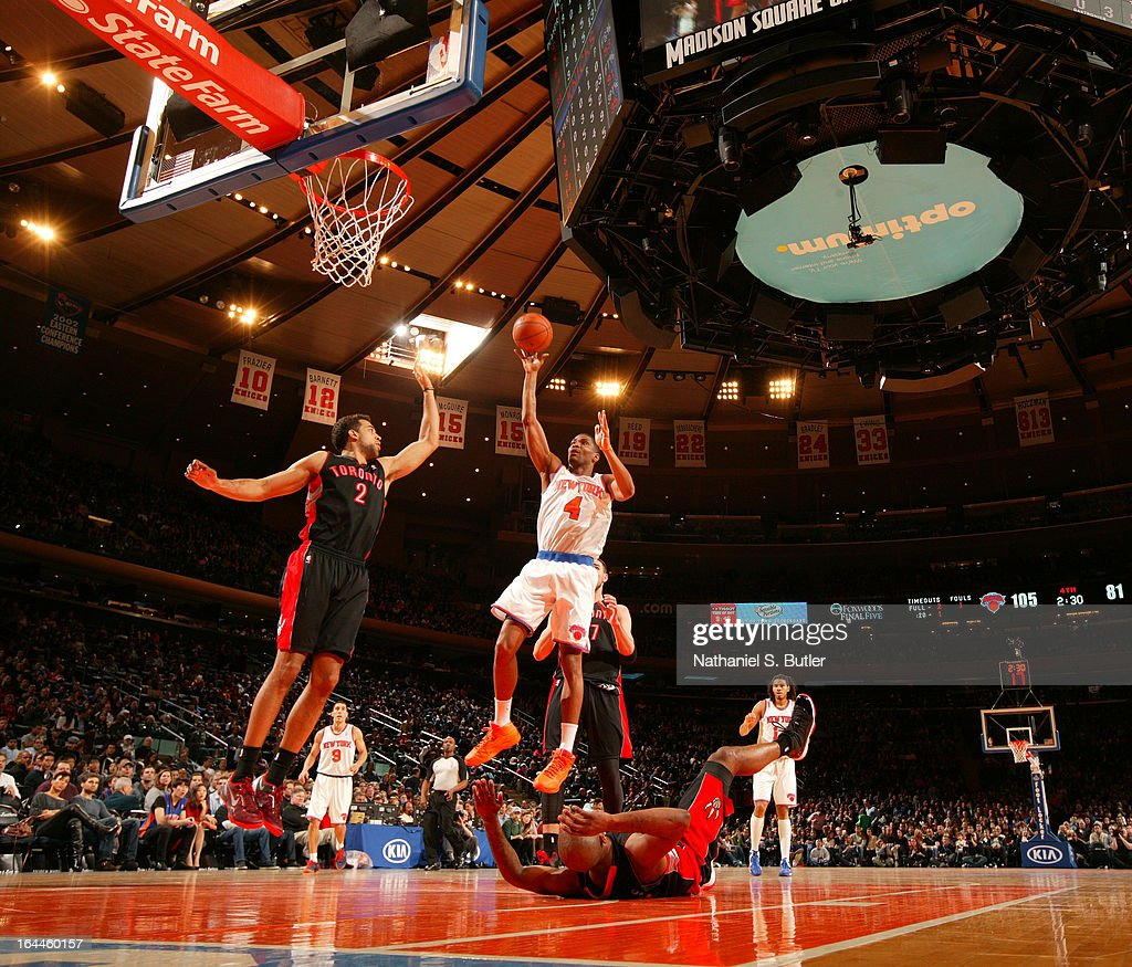 James White #4 of the New York Knicks shoots over <a gi-track='captionPersonalityLinkClicked' href=/galleries/search?phrase=Landry+Fields&family=editorial&specificpeople=4184645 ng-click='$event.stopPropagation()'>Landry Fields</a> #2 of the Toronto Raptors on March 23, 2013 at Madison Square Garden in New York City.