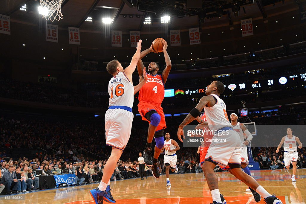 James White #4 of the Philadelphia 76ers attempts a shot against Steve Novak #16 of the New York Knicks on November 4, 2012 at Madison Square Garden in New York City.