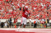 James White of the Wisconsin Badgers celebrates after running for a touchdown during the game against the Tennessee Tech Golden Eagles at Camp...