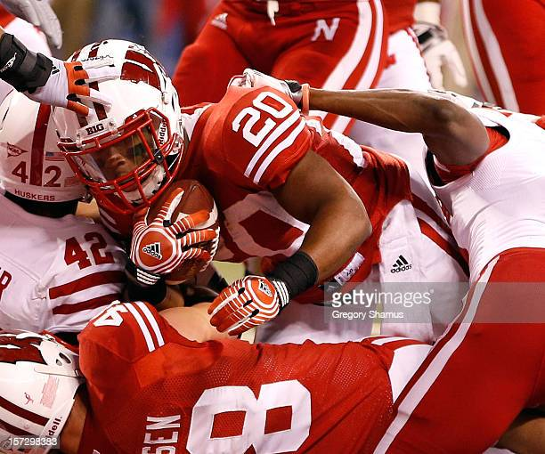 James White of the Wisconsin Badgers dives through the pile for a second quarter touchdown while playing the Nebraska Cornhuskers in the Big 10...