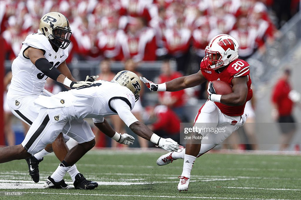 James White #20 of the Wisconsin Badgers runs away from the defense against the Purdue Boilermakers during the game at Camp Randall Stadium on September 21, 2013 in Madison, Wisconsin.