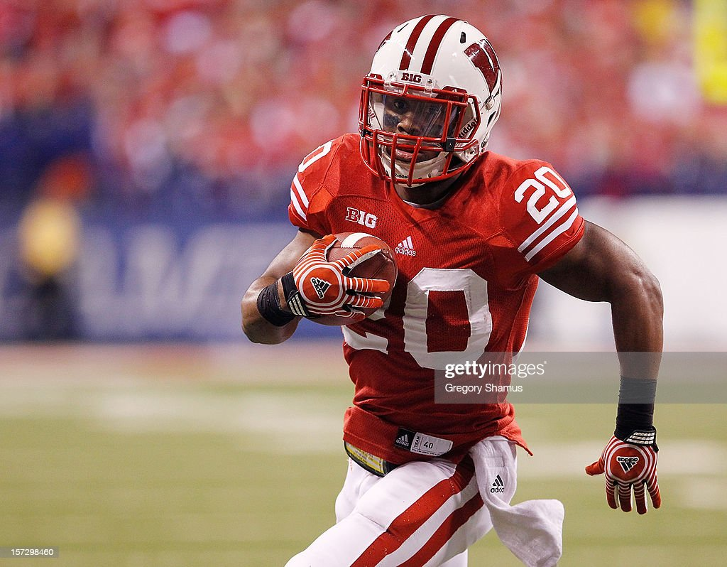 James White #20 of the Wisconsin Badgers runs for a first quarter touchdown while playing the Nebraska Cornhuskers during the Big 10 Conference Championship Game at Lucas Oil Stadium on December 1, 2012 in Indianapolis, Indiana.