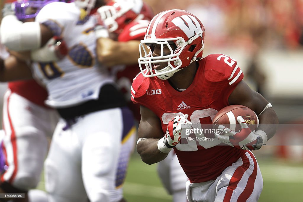 James White #20 of the Wisconsin Badgers runs upfield with the football during the second half against the Tennessee Tech Golden Eagles at Camp Randall Stadium on September 07, 2013 in Madison, Wisconsin.