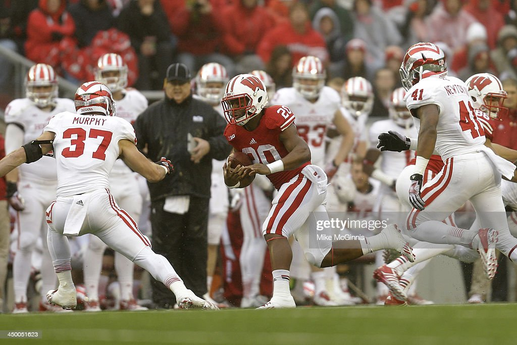 James White #20 of the Wisconsin Badgers runs with the football during the first half of play against the Indiana Hoosiers at Camp Randall Stadium on November 16, 2013 in Madison, Wisconsin.