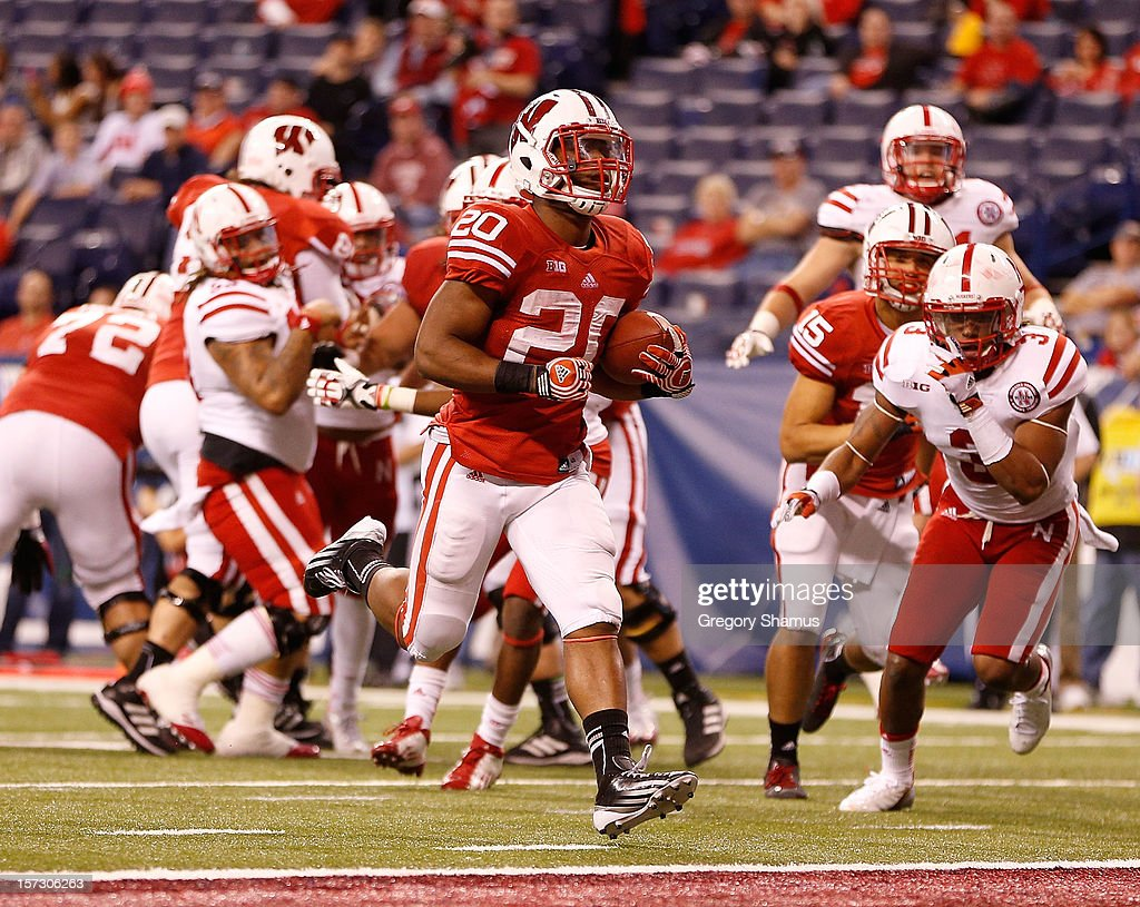 James White #20 of the Wisconsin Badgers walks in for a fourth quarter touchdown while playing the Nebraska Cornhuskers during the Big 10 Conference Championship Game at Lucas Oil Stadium on December 1, 2012 in Indianapolis, Indiana.
