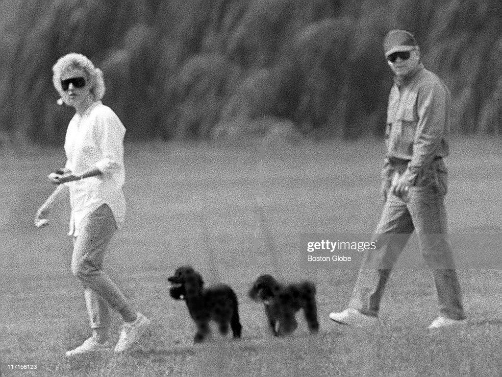 Whitey Bulger and Catherine Greig walk together with Greig's poodles underfoot
