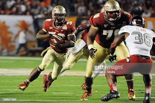 James Wilder Jr #32 of the Florida State Seminoles carries the ball against the Northern Illinois Huskies during the Discover Orange Bowl at Sun Life...