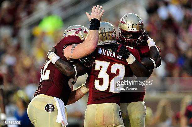 James Wilder Jr #32 of the Florida State Seminoles celebrates a touchdown against the BethuneCookman Wildcats during a game at Doak Campbell Stadium...