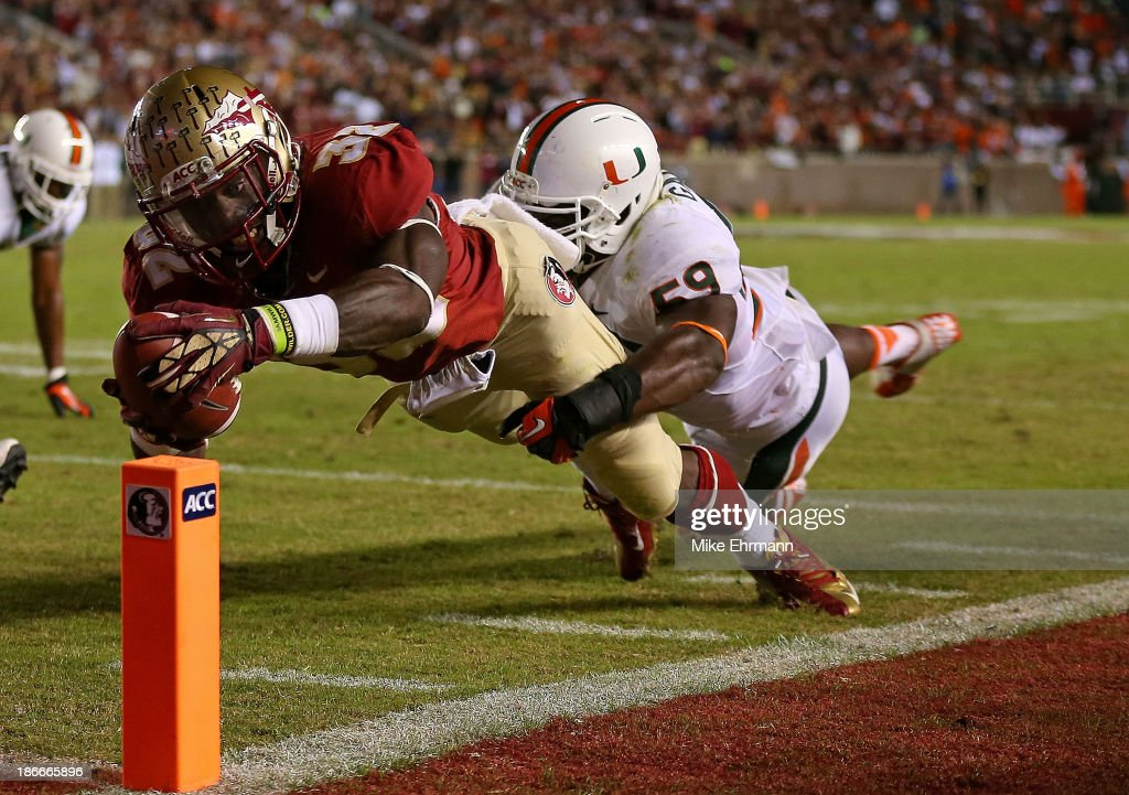 James Wilder Jr #32 of the Florida State Seminoles dives for a touchdown during a game against the Miami Hurricanes at Doak Campbell Stadium on...