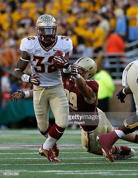 James Wilder Jr #32 of the Florida State Seminoles gains yards against the Brian Mihalik of the Boston College Eagles in the second half at Alumni...