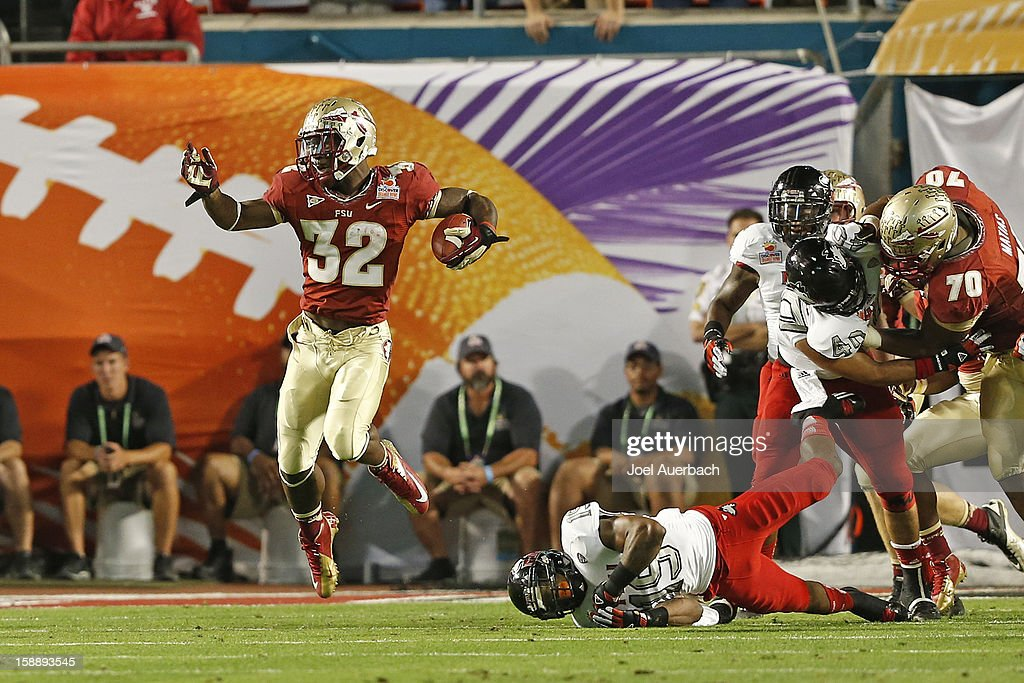 James Wilder Jr. #32 of the Florida State Seminoles runs with the ball after eluding the tackle by Demetrius Stone #19 of the Northern Illinois Huskies during the 2013 Discover Orange Bowl at Sun Life Stadium on January 1, 2013 in Miami, Florida. The Seminoles defeated the Huskies 31-10.