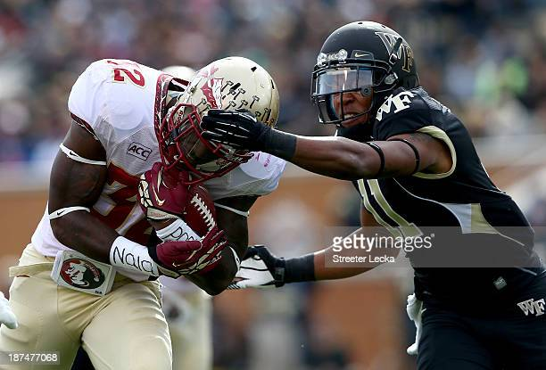 James Wilder Jr #32 of the Florida State Seminoles tries to get away from Anthony Wooding Jr #11 of the Wake Forest Demon Deacons during their game...
