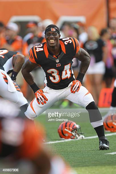 James Wilder Jr #34 of the Cincinnati Bengals warms up before the game against the Indianapolis Colts at Paul Brown Stadium on August 28 2014 in...