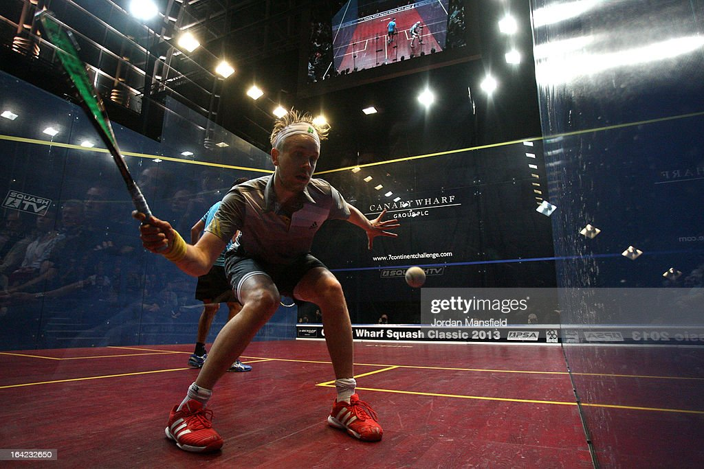 James Willstrop of England in action against Mohamed El Shorbagy of Egypt during their semi-final match a in the Canary Wharf Squash Classic on March 21, 2013 in London, England.