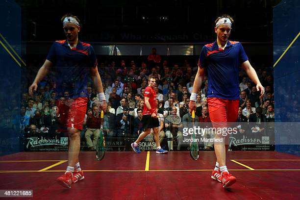 James Willstrop of England looks dejected reflected in the glass of the court after losing a point to Nick Matthew of England during the final of the...