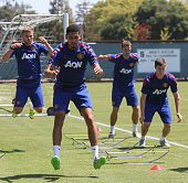James Wilson Chris Smalling Jonny Evans and Patrick McNair of Manchester United in action during a first team training session as part of their...