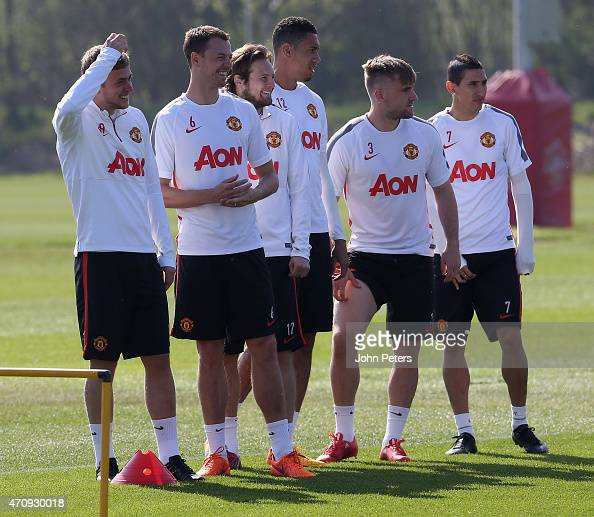 James Wilson Jonny Evans Daley Blind Chris Smalling Luke Shaw and Angel di Maria of Manchester United in action during a first team training session...