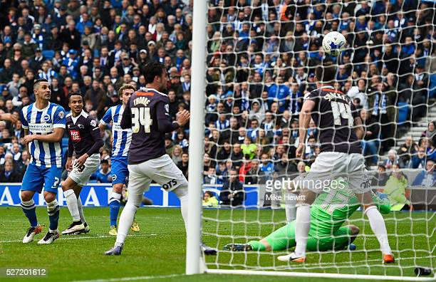 James Wilson of Brighton and Hove Albion scores an injury time goal tolevel the scores at 11 during the Sky Bet Championship match between Brighton...