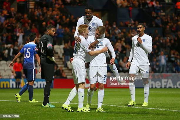 James Wilson of England celebrates with Duncan Watmore and Nathaniel Chalobah of England after scoring the first goal of the game during the...
