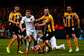 James Wilson of Manchester United battles for the ball with Josh Coulson of Cambridge United during the FA Cup Fourth Round match between Cambridge...
