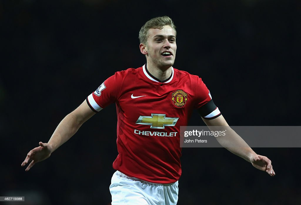 James Wilson of Manchester United celebrates scoring their third goal during the FA Cup Fourth Round replay between Manchester United and Cambridge United at Old Trafford on February 3, 2015 in Manchester, England.