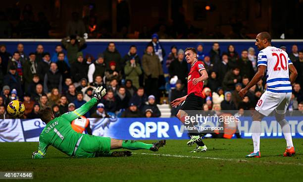 James Wilson of Manchester United scores his team's second goal past Robert Green of QPR during the Barclays Premier League match between Queens Park...