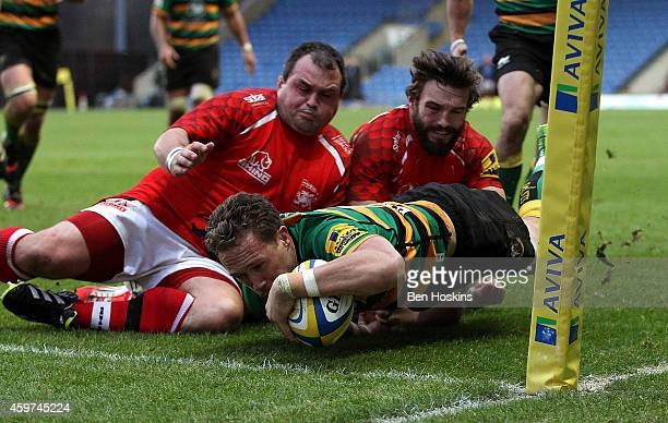James Wilson of Northampton dives over to score a try during the Aviva Premiership match between London Welsh v Northampton Saints at Kassam Stadium...