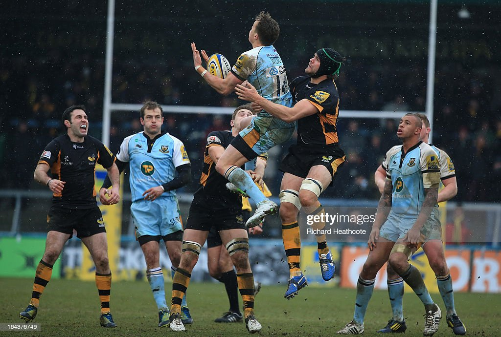 James Wilson of Northampton Saints beats <a gi-track='captionPersonalityLinkClicked' href=/galleries/search?phrase=Tom+Palmer&family=editorial&specificpeople=233666 ng-click='$event.stopPropagation()'>Tom Palmer</a> of London Wasps to the ball during the Aviva Premiership match between London Wasps and Northampton Saints at Adams Park on March 23, 2013 in High Wycombe, England.