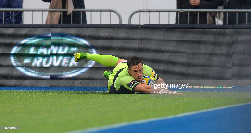 <a gi-track='captionPersonalityLinkClicked' href=/galleries/search?phrase=James+Wilson+-+Rugby+Player&family=editorial&specificpeople=13770852 ng-click='$event.stopPropagation()'>James Wilson</a> of Northampton Saints scores their first try during the Aviva Premiership match between Saracens and Northampton Saints at Allianz Park on November 23, 2014 in Barnet, England.