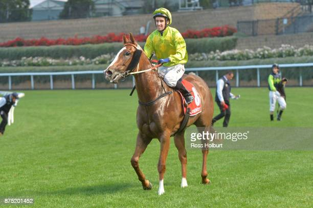 James Winks returns to the mounting yard on Sprightly Lass after winning the Excellence in Baking 2018 Handicap at Moonee Valley Racecourse on...