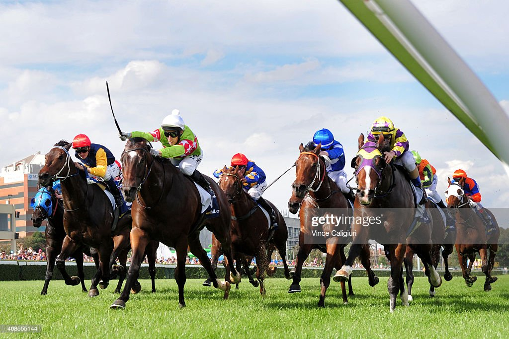 James Winks riding Prince Harada defeats Jake Bayliss riding Boomwa in Race 4 during Melbourne racing at Caulfield Racecourse on April 4 2015 in...