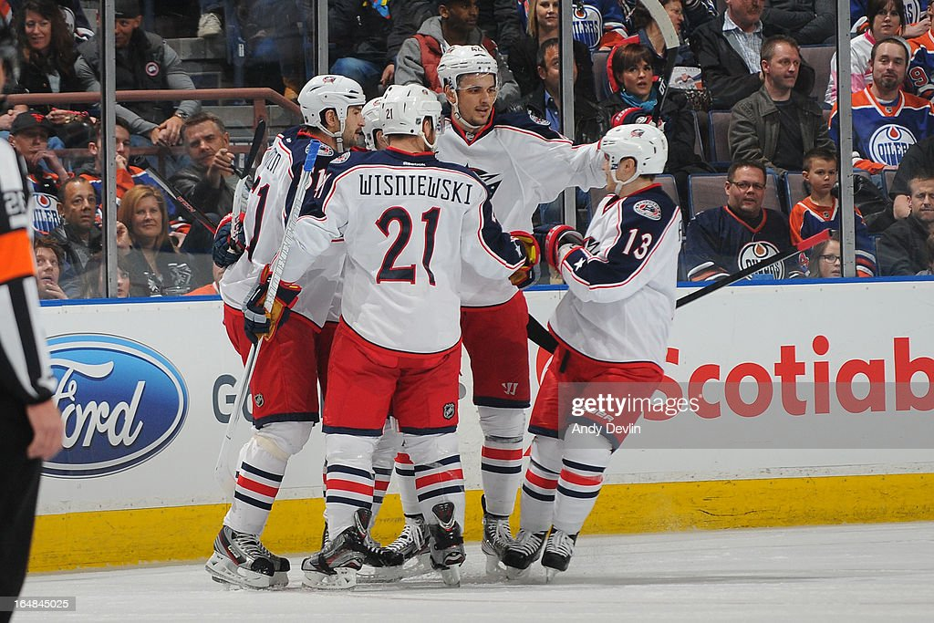 James Wisniewski and Cam Atkinson of the Columbus Blue Jackets celebrate with team mates after scoring a goal against the Edmonton Oilers on March 28...