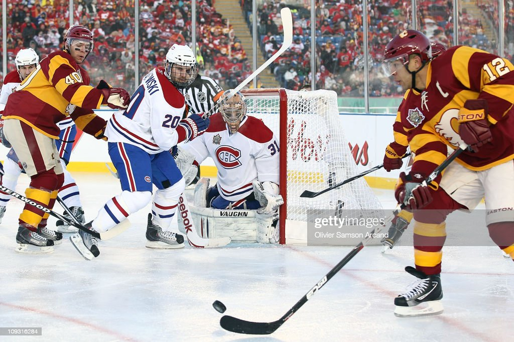 James Wisniewski and Carey Price of the Montreal Canadiens defend against Jarome Iginla and Alex Tanguay of the Calgary Flames during the 2011...