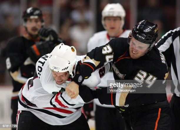 James Wisniewski of the Anaheim Ducks punches Nick Boynton of the Chicago Blackhawks during their fight in the third period of their NHL game at the...