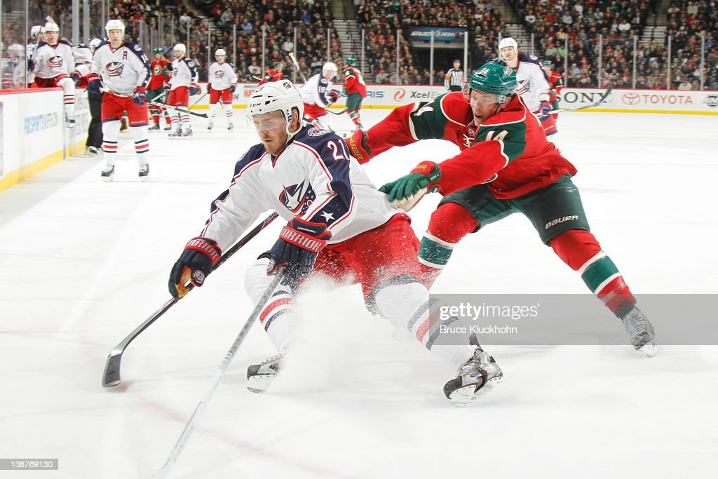 <a gi-track='captionPersonalityLinkClicked' href=/galleries/search?phrase=James+Wisniewski&family=editorial&specificpeople=688111 ng-click='$event.stopPropagation()'>James Wisniewski</a> #21 of the Columbus Blue Jackets and <a gi-track='captionPersonalityLinkClicked' href=/galleries/search?phrase=Darroll+Powe&family=editorial&specificpeople=4527845 ng-click='$event.stopPropagation()'>Darroll Powe</a> #14 of the Minnesota Wild skate to the puck during the game at the Xcel Energy Center on February 11, 2012 in St. Paul, Minnesota.