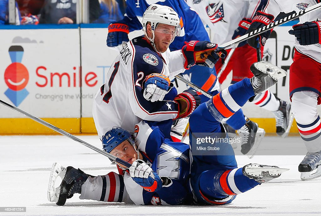 James Wisniewski of the Columbus Blue Jackets and Mikhail Grabovski of the New York Islanders collide at center ice at Nassau Veterans Memorial...