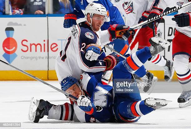 James Wisniewski of the Columbus Blue Jackets and Mikhail Grabovski of the New York Islanders collide at center ice at Nassau Veterans Memorial...