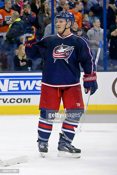 James Wisniewski of the Columbus Blue Jackets celebrates after defeating the Philadelphia Flyers 63 on December 21 2013 at Nationwide Arena in...
